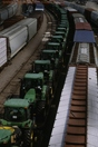 Freight trains from above, John Deere tractors on flat cars
